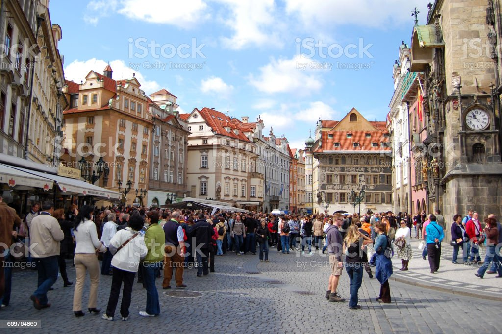 Tourists on the old town square in Prague stock photo