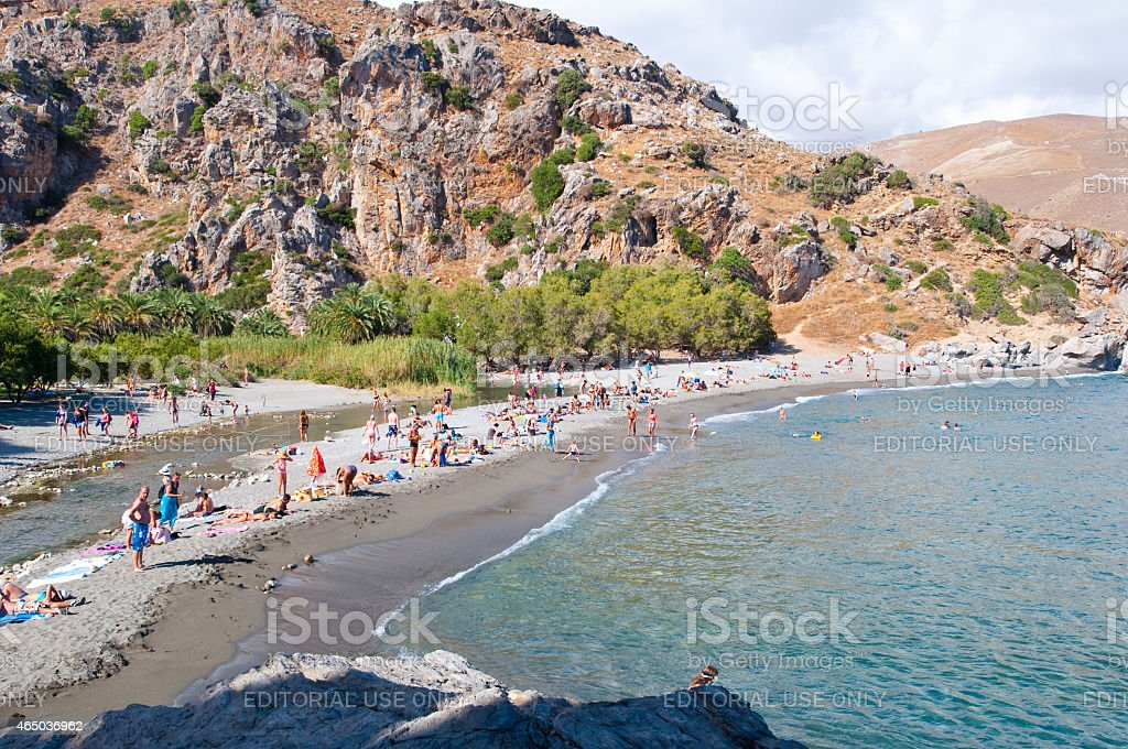 Tourists on the Preveli Beach on Crete, Greece. stock photo