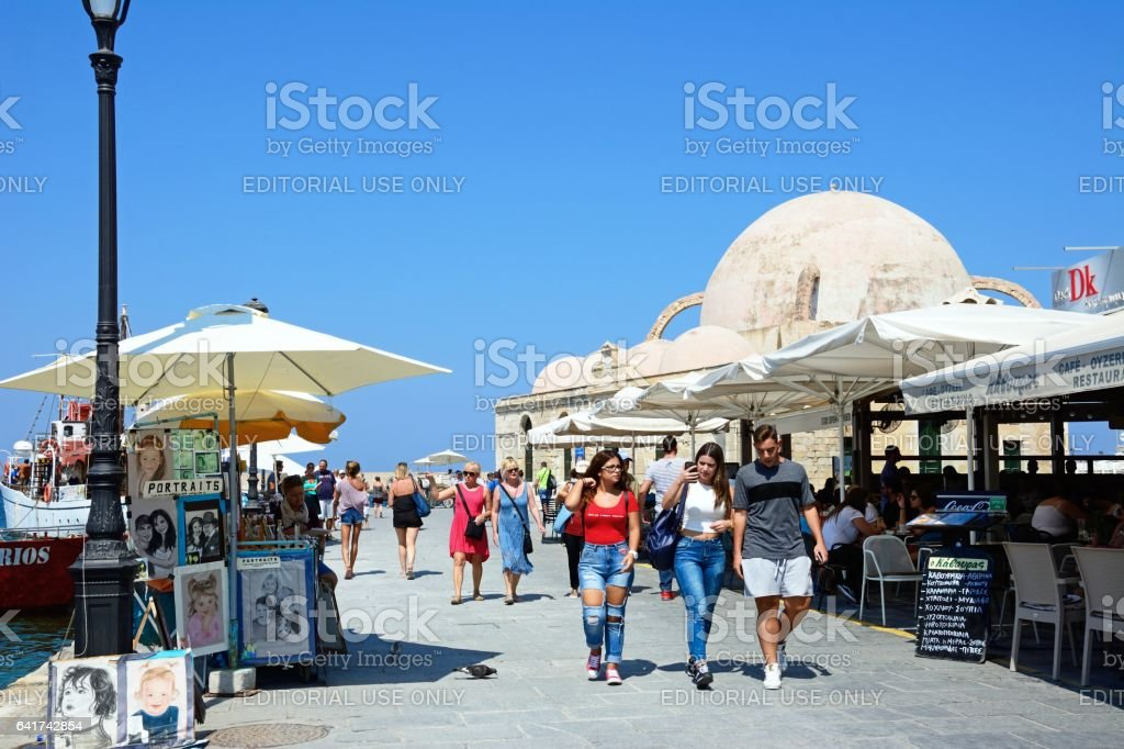 Tourists on the quayside, Chania. stock photo