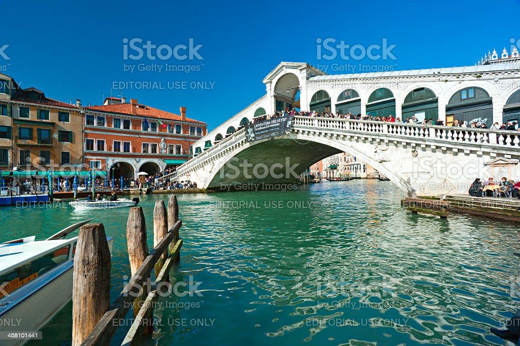 Tourists on the Rialto Bridge during Venice Carnival. stock photo