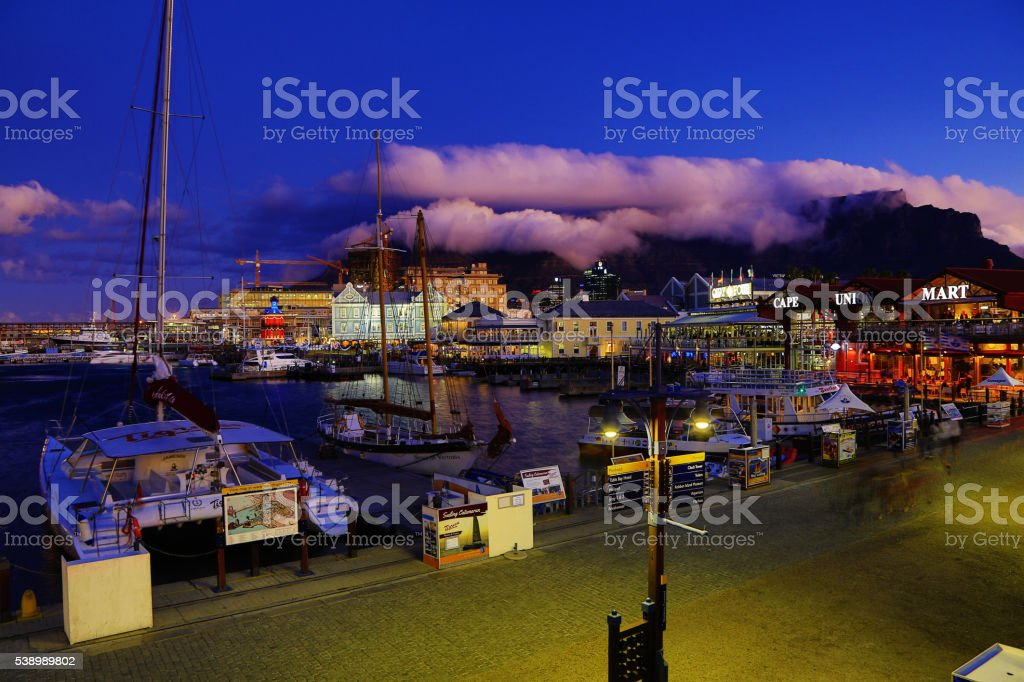 Tourists on the walkway at Victoria & Alfred Waterfront, Capetown stock photo