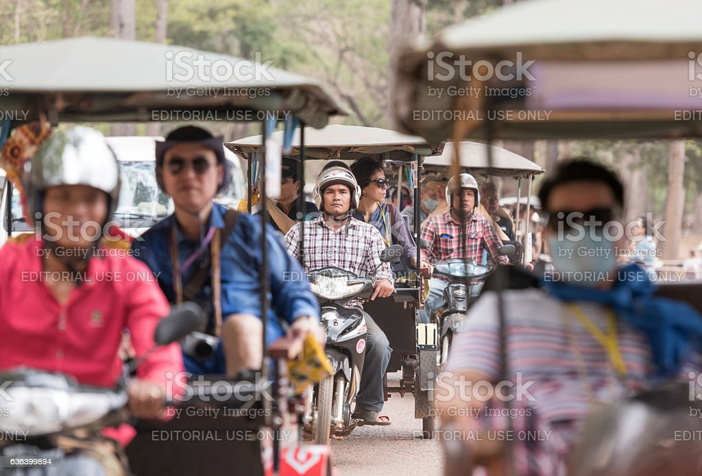 Tourists on their way to Angkor Wat, Cambodia stock photo