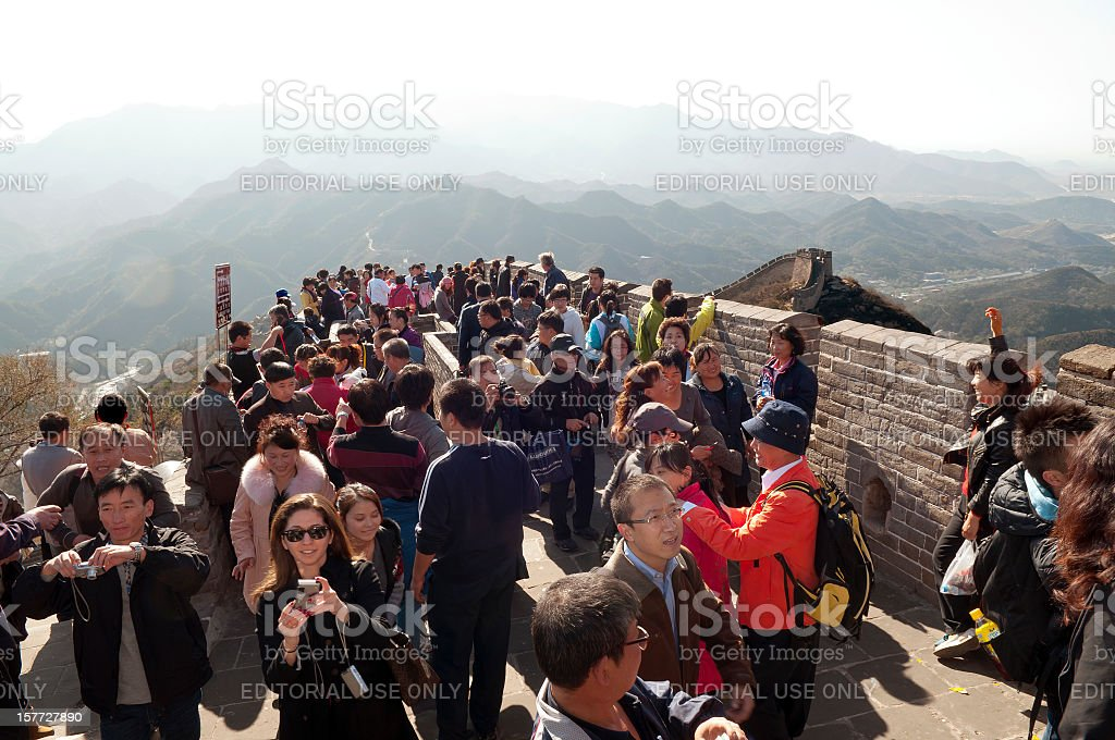 Tourists on Top of Great Wall in China stock photo
