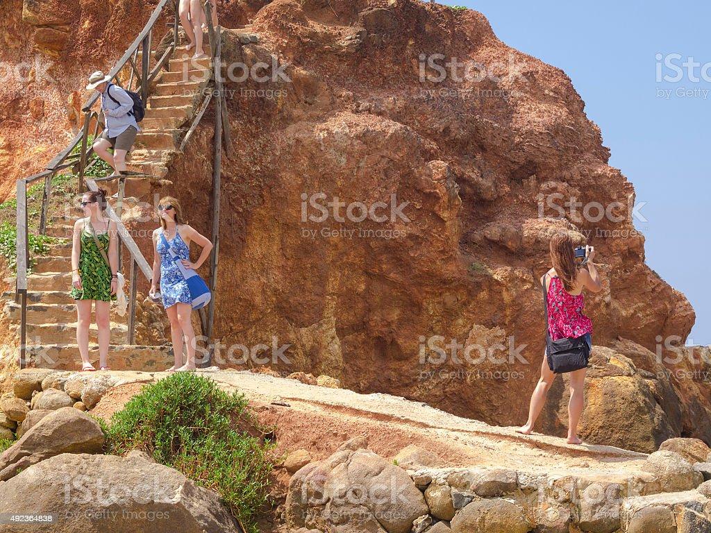 Tourists on view island across Mirissa beach in Sri Lanka stock photo