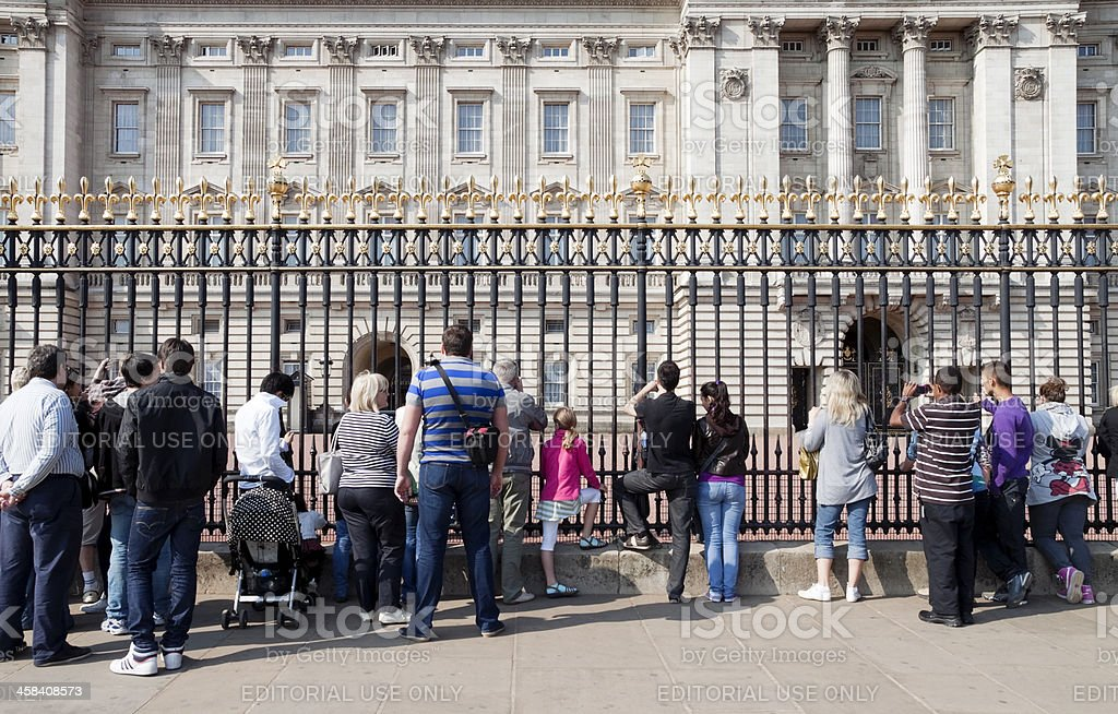 Tourists outside Buckingham Palace stock photo