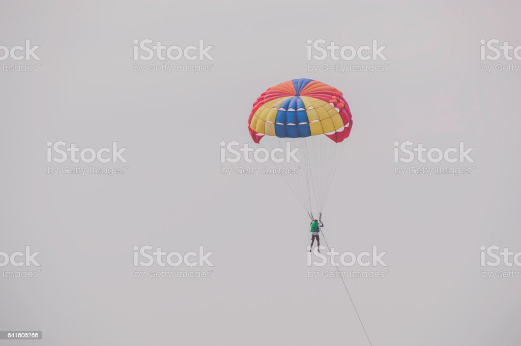 Tourists parasailing on Pattaya Beach stock photo