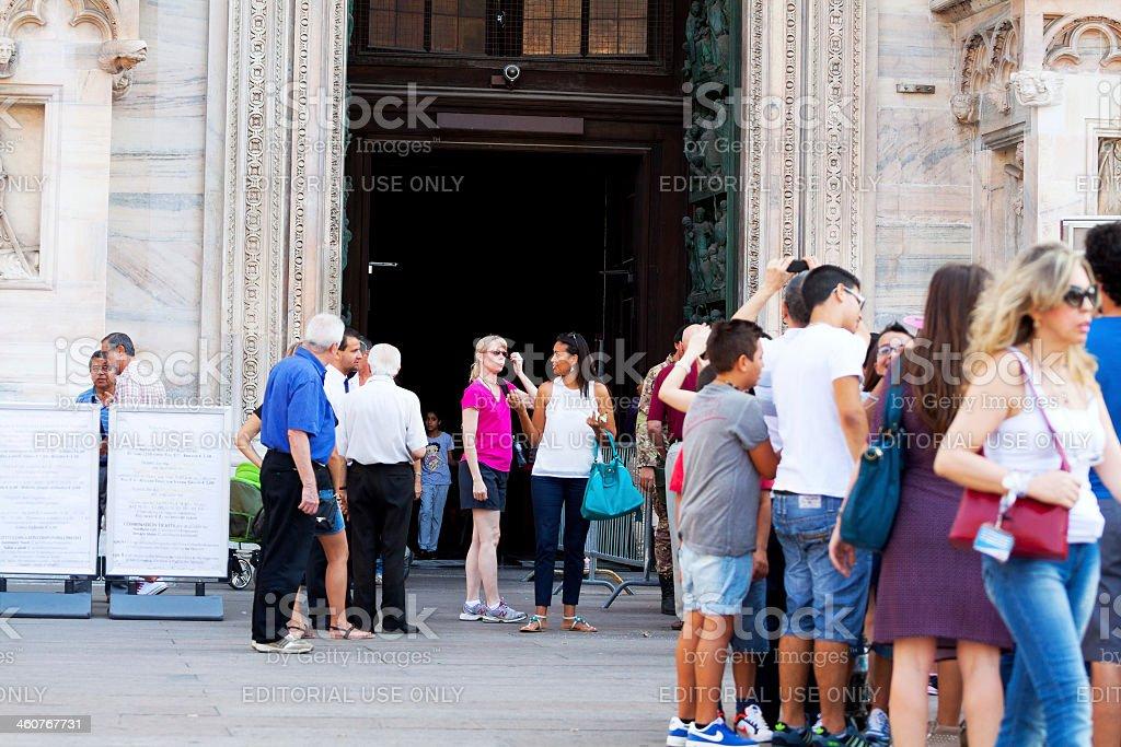 Tourists queue at Duomo Maria Nascente stock photo