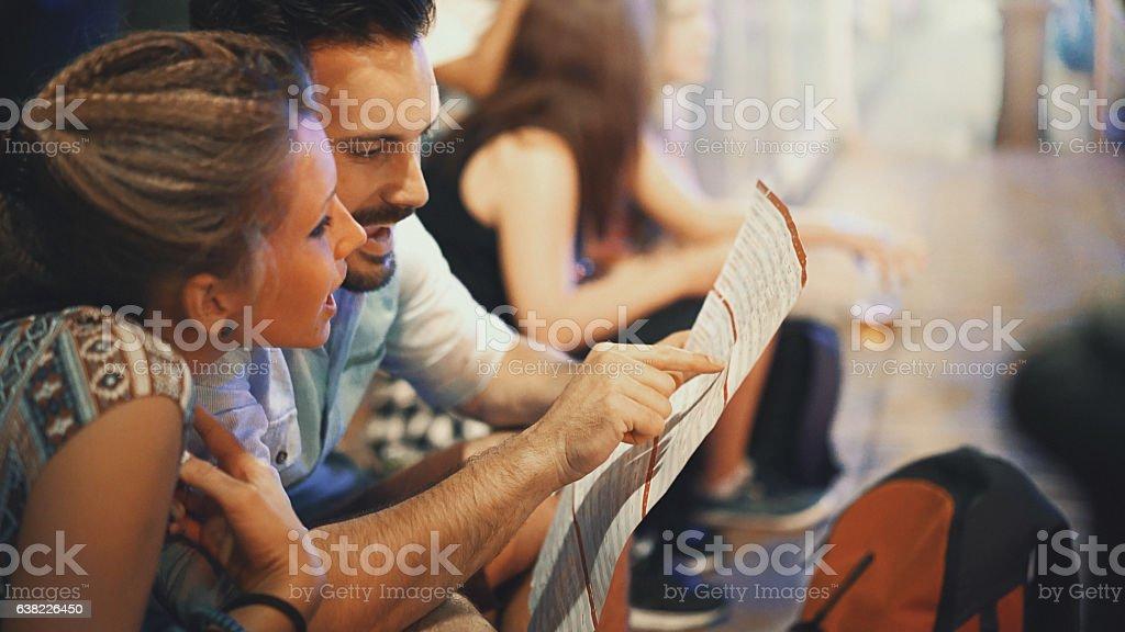 Tourists reading city map. stock photo