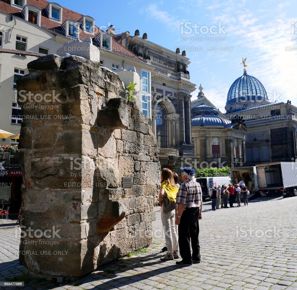 Tourists reading inscription on remains of Frauenkirche church stock photo
