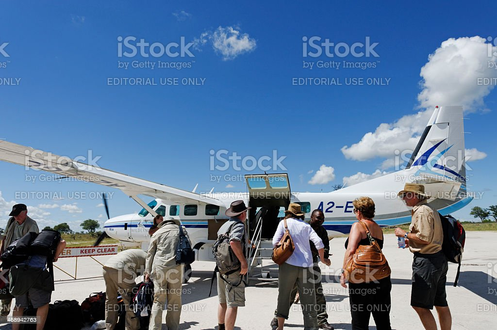 Tourists ready to board  plane at  Selinda Concession in Botswana stock photo