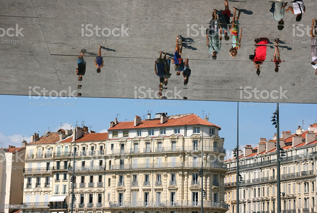 Tourists reflecting in a mirror, the vieux port, Marseille. stock photo