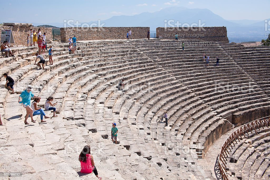 Tourists regard antique amphitheater in the ancient city of Hierapolis stock photo