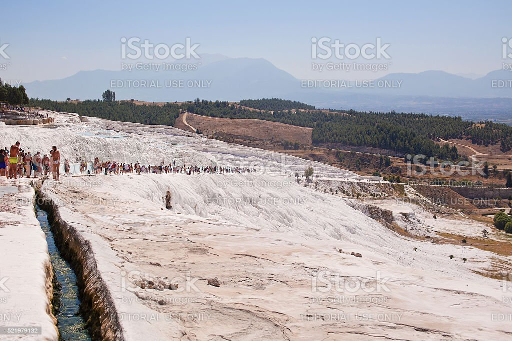 Tourists regard the travertines with pools and terraces at Pamukkale stock photo