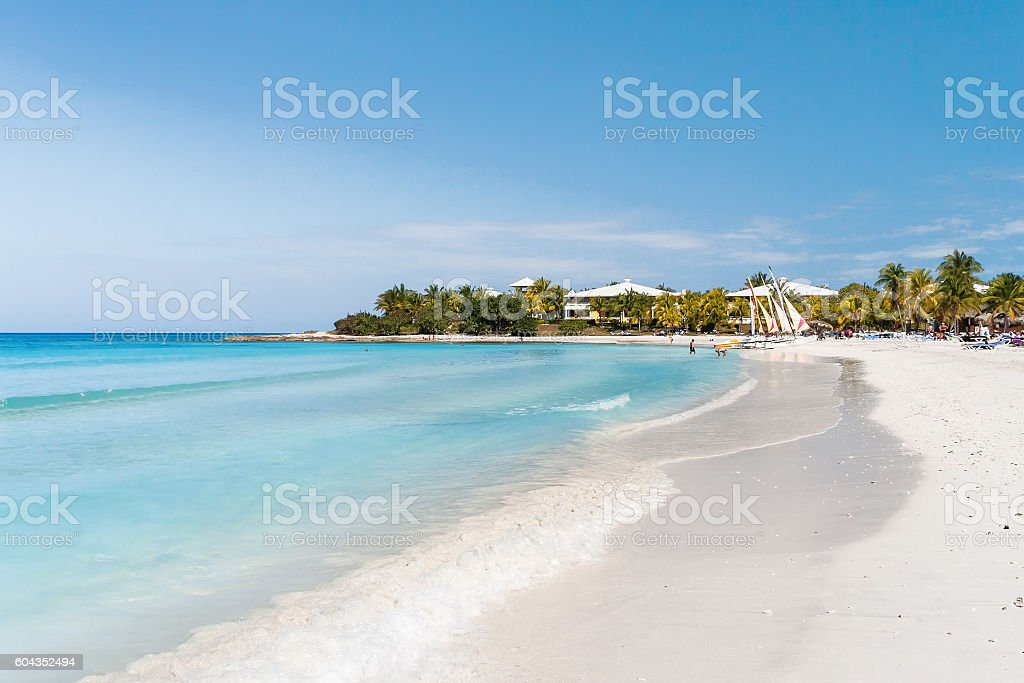Tourists relax on Varadero sandy beach. Cuba. stock photo