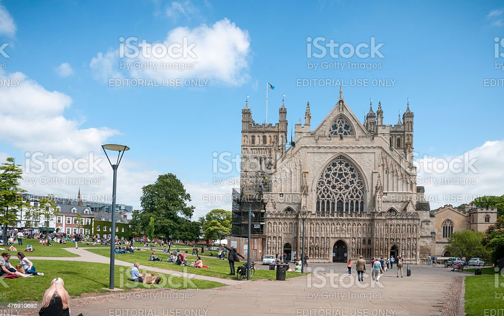 Tourists Relaxing In The Gardens Around A Cathedral stock photo