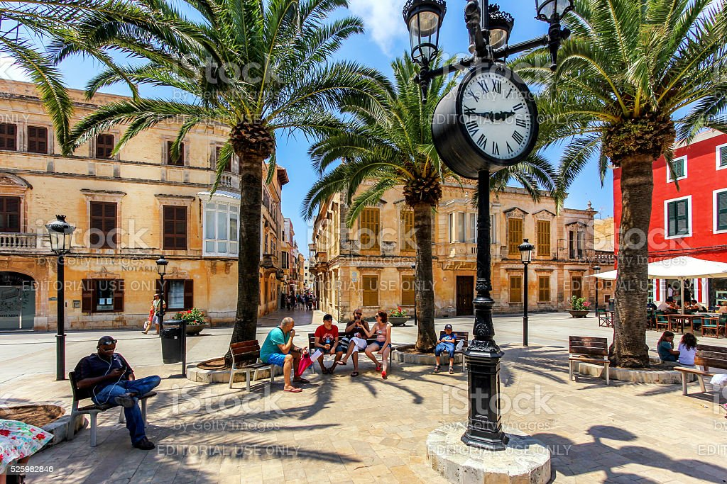 Tourists relaxing on Plaza Alfonzo III stock photo