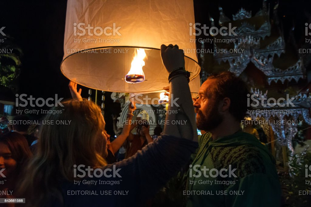 Tourists release floating lanterns in Chiang Mai, Thailand stock photo