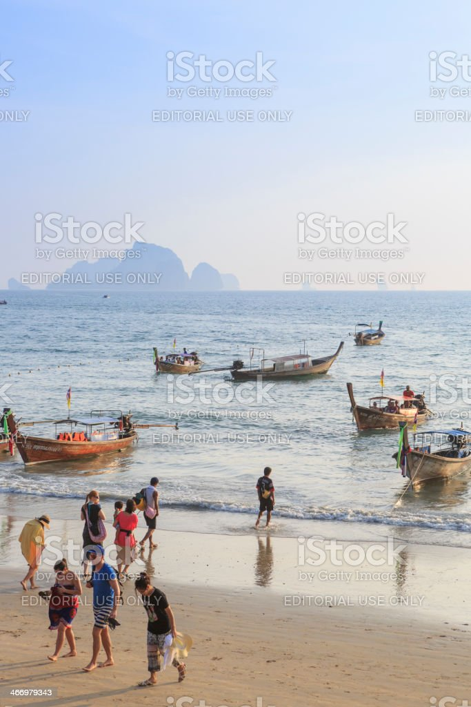Tourists return from longtail boat trip stock photo