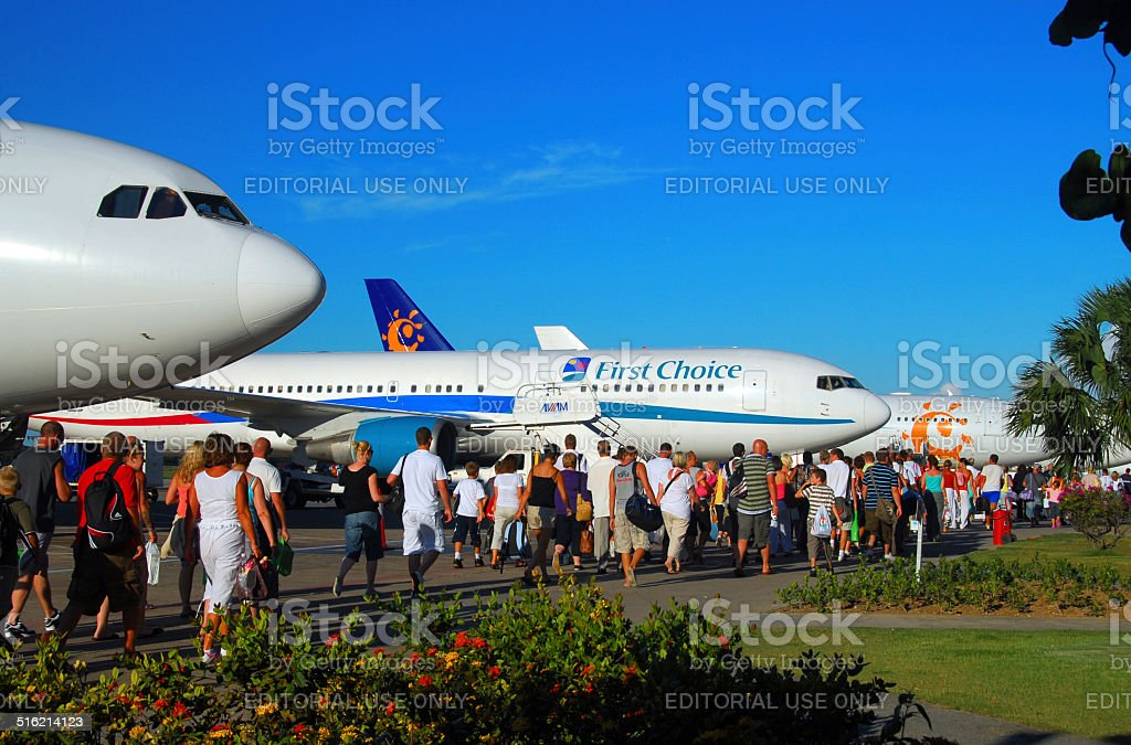 Tourists return home from the Caribbean stock photo