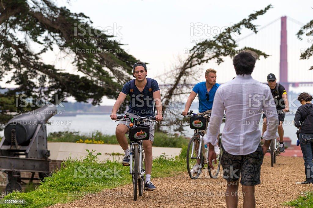Tourists ride rental bikes in San Francisco stock photo
