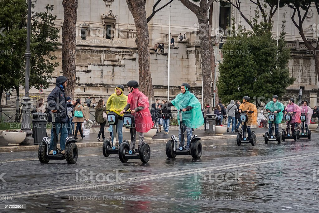 Tourists ride Segways.  Scenes from Rome at Easter stock photo