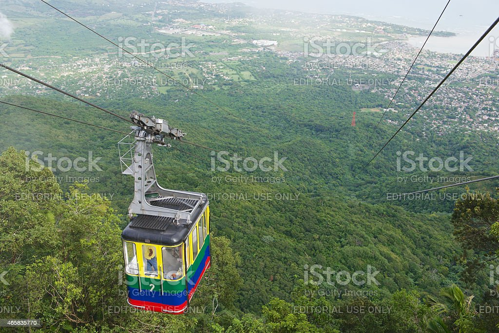 Tourists ride the cable car in Puerto Plata, Dominican Republic. stock photo