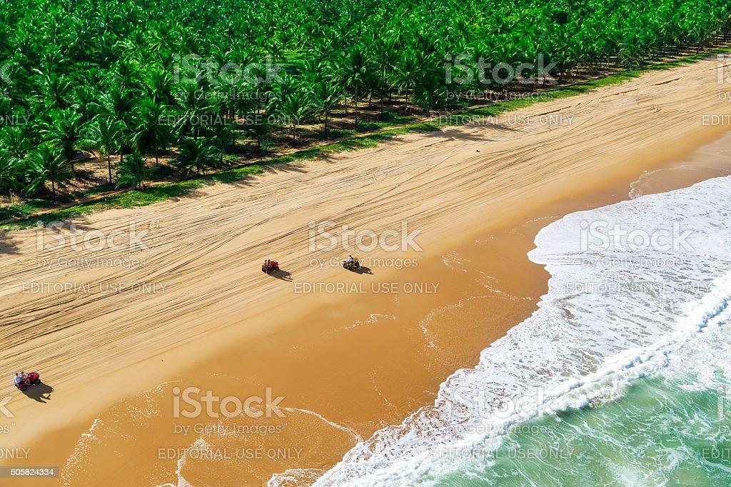 Tourists riding quadricycles in Maceio Beach stock photo