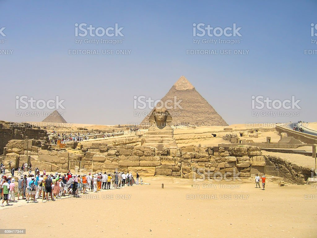 Tourists seeing the Sphynx statue and great pyramids stock photo