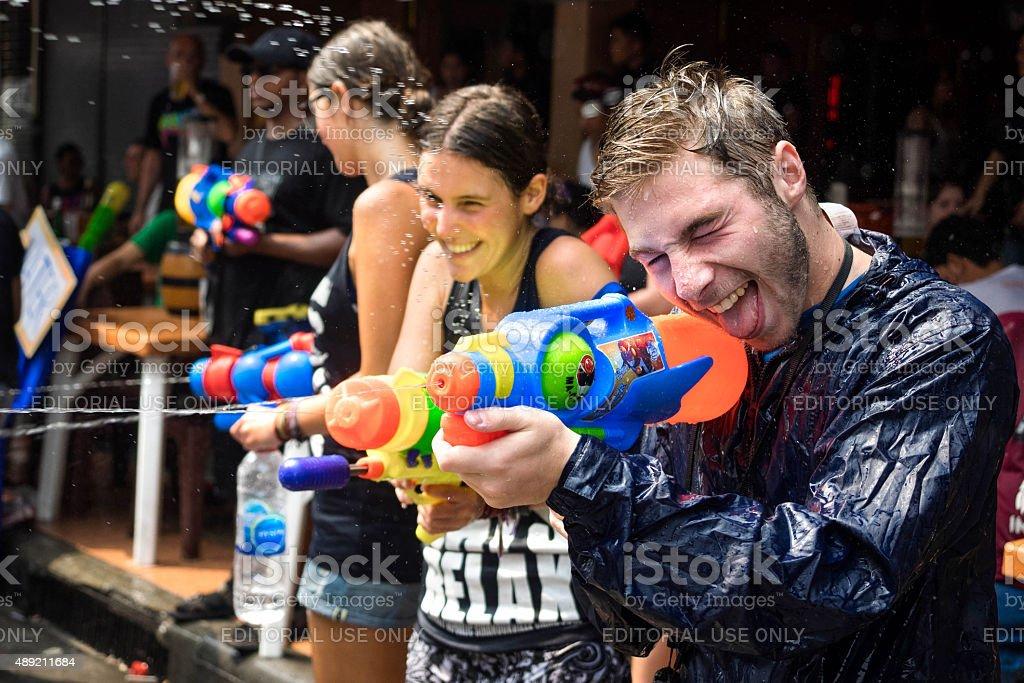 Tourists Shooting Water Guns at Songkran Festival, Bangkok, Thailand stock photo