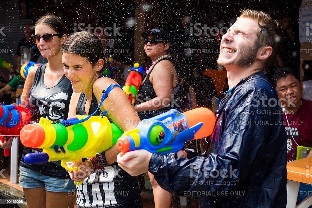 Tourists Shooting Water Guns at Songkran Festival in Bangkok, Thailand stock photo
