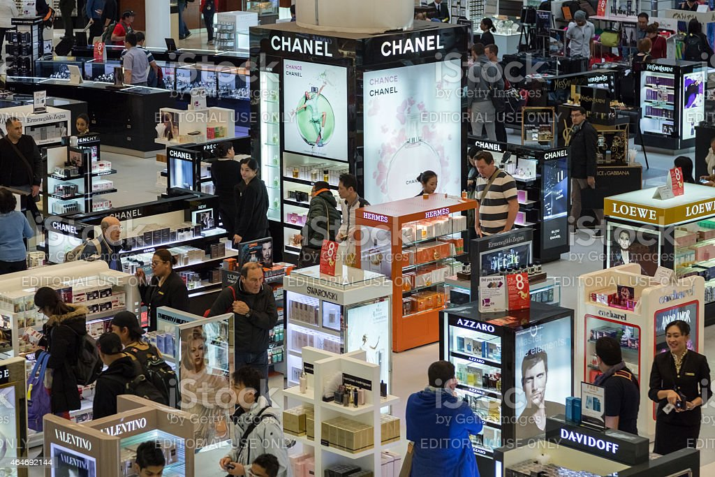Tourists shopping at Duty Free Shop at Doha International Airport stock photo