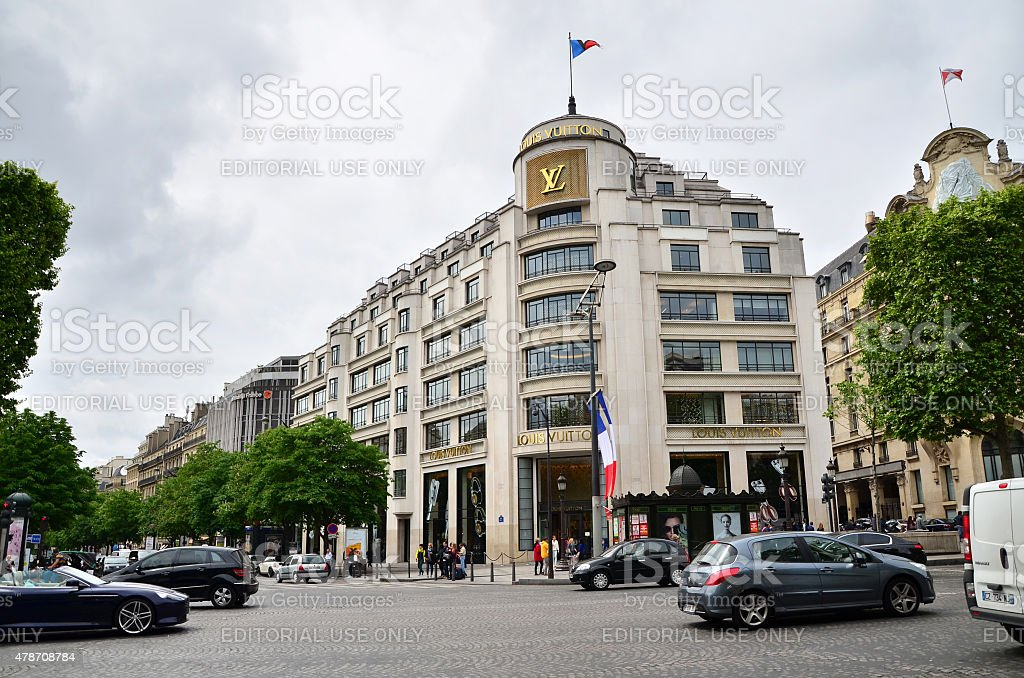 Tourists Shopping at Louis Vuitton Store in Paris, France. stock photo