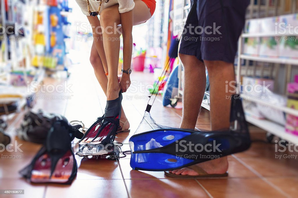 tourists shopping for flippers royalty-free stock photo