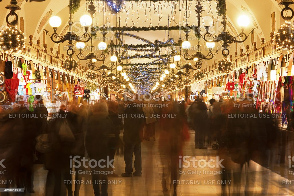 Tourists Shopping in Cloth Hall with Christmas Decorations, Cracow, Poland royalty-free stock photo