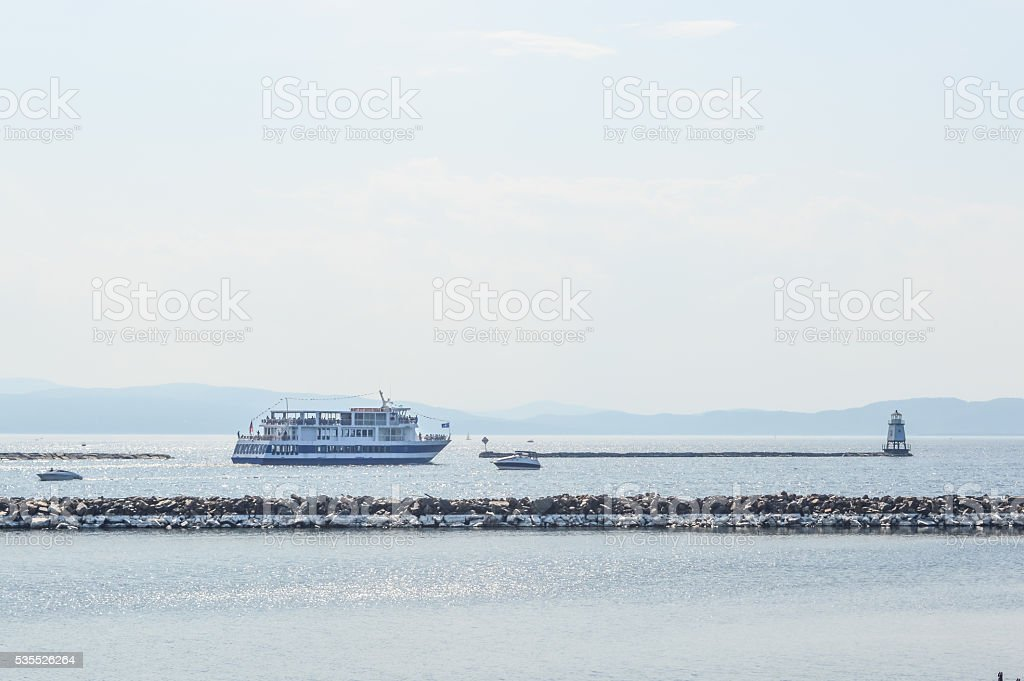 Tourists sit on the deck of the popular sightseeing ship stock photo