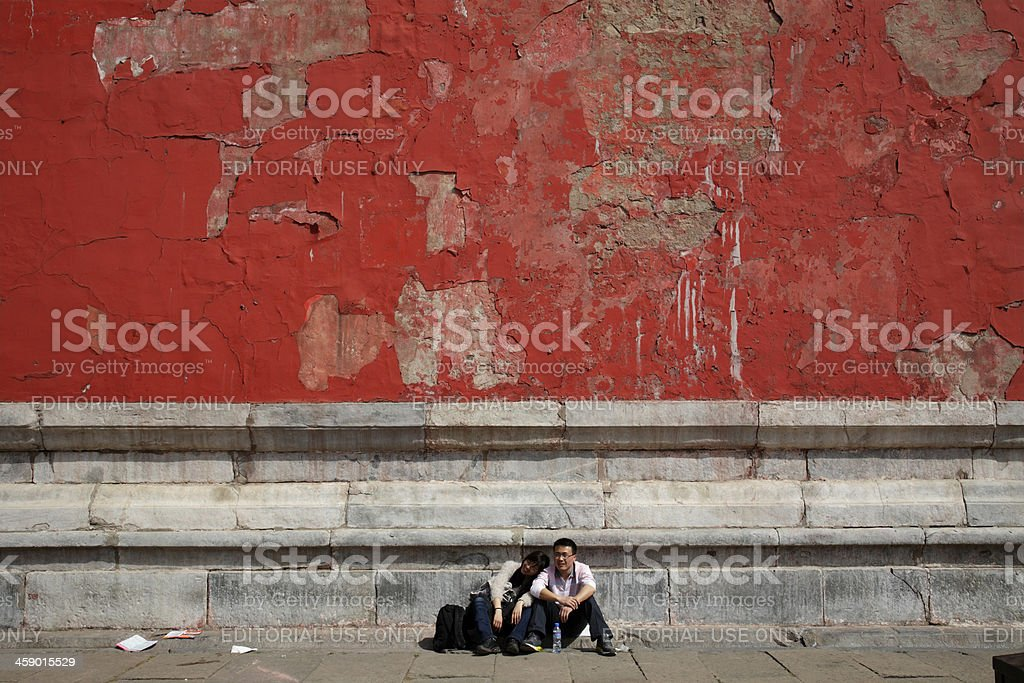 Tourists sit outside the Meridian Gate in Beijing royalty-free stock photo