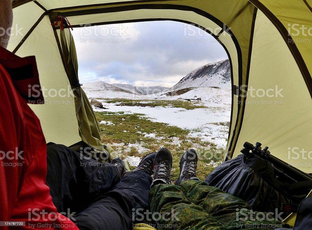 Tourists sitting inside the tent stock photo