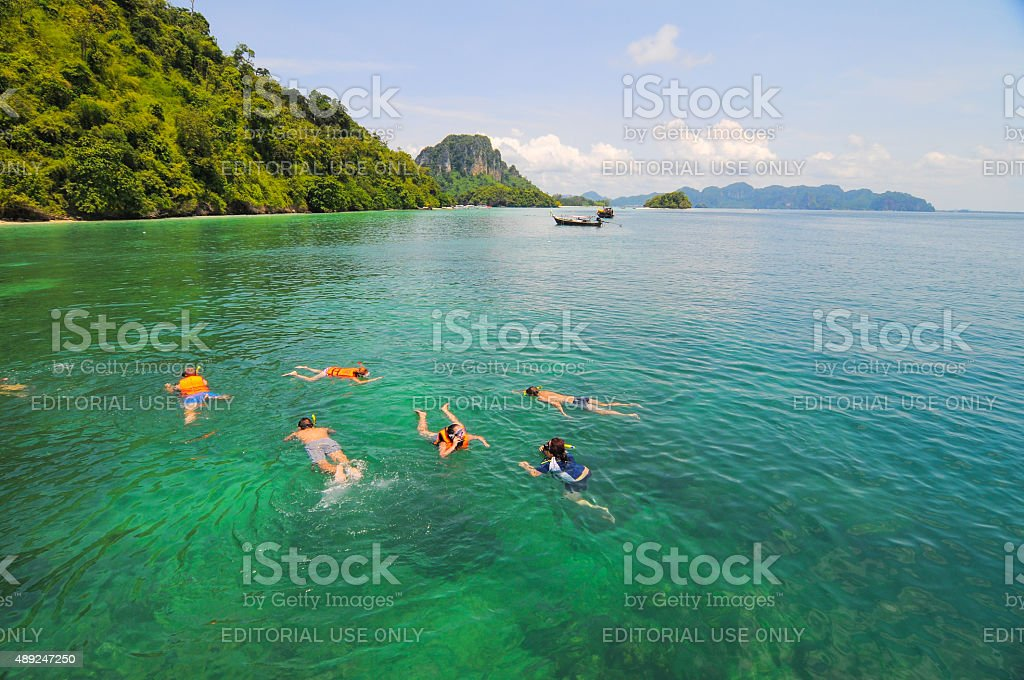 Tourists snorkeling in a tropical clear sea stock photo