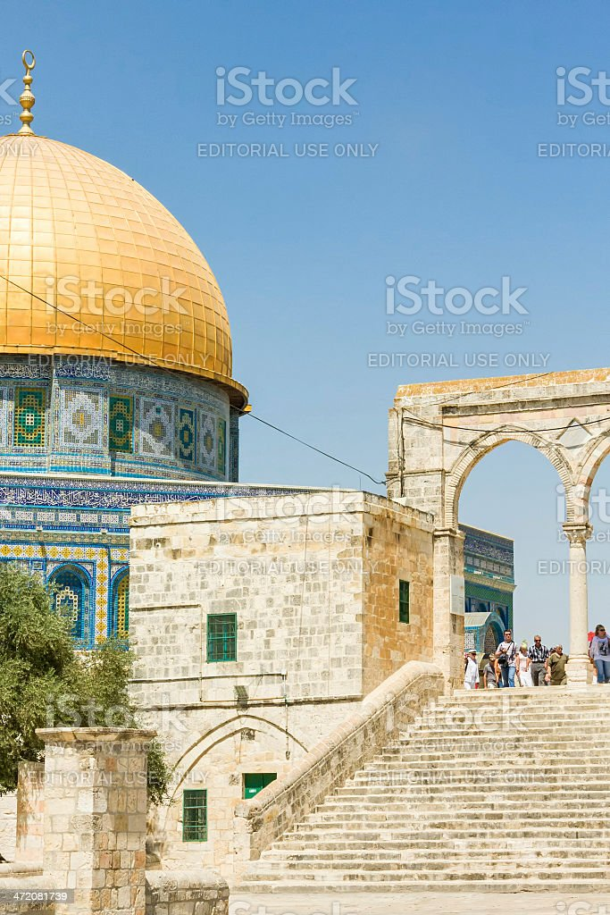 Tourists stand over stairs from Dome of the Rock Mosque royalty-free stock photo