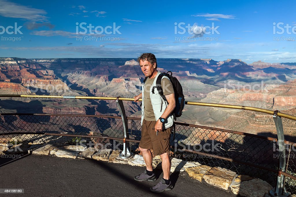 Tourists standing at the lookout point Grand Canyon, Arizona USA stock photo