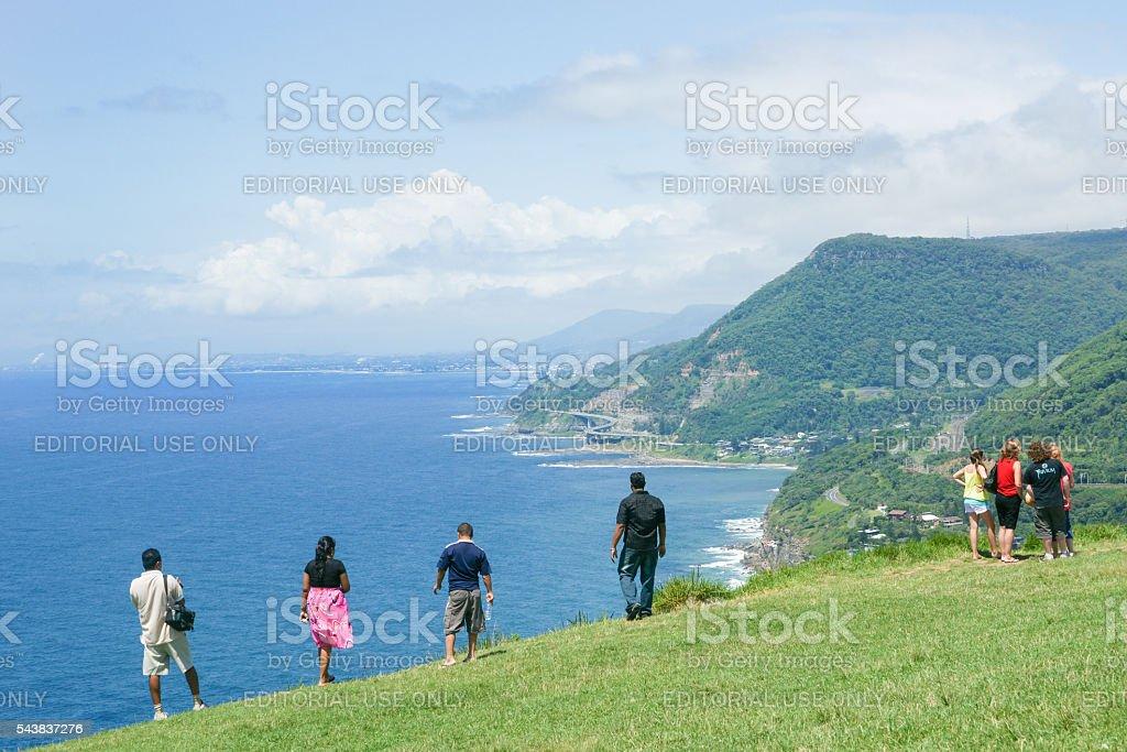 Tourists stop to take in view  distant Sea Cliff Bridge stock photo