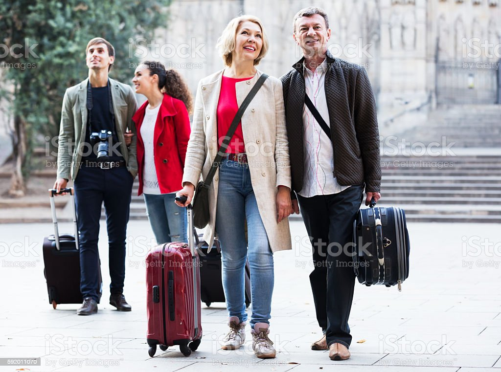Tourists strolling outdoors stock photo