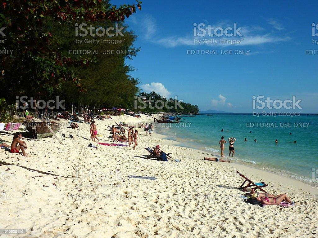 Tourists sunbathing at Long Beach, PhiPhi island, Thailand stock photo