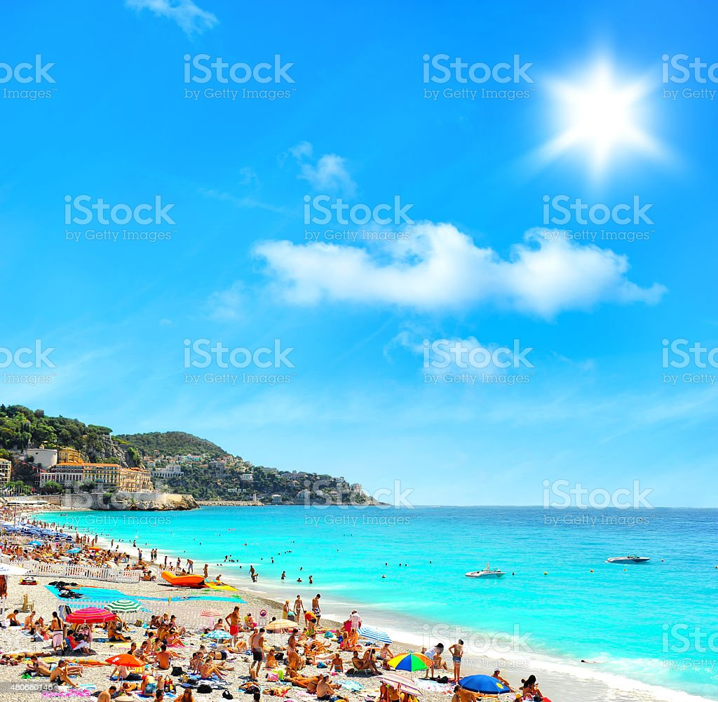 Tourists, sunbeds and umbrellas on hot day. Travel background stock photo