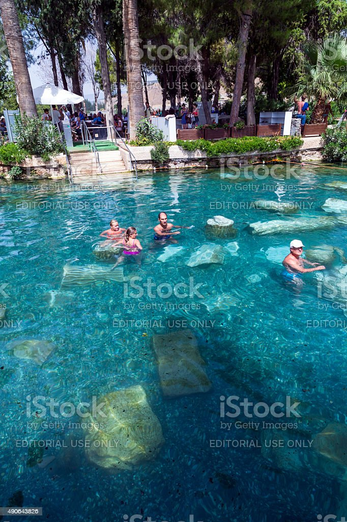 Tourists swimming in Cleopatra's Pool in Pamukkale stock photo