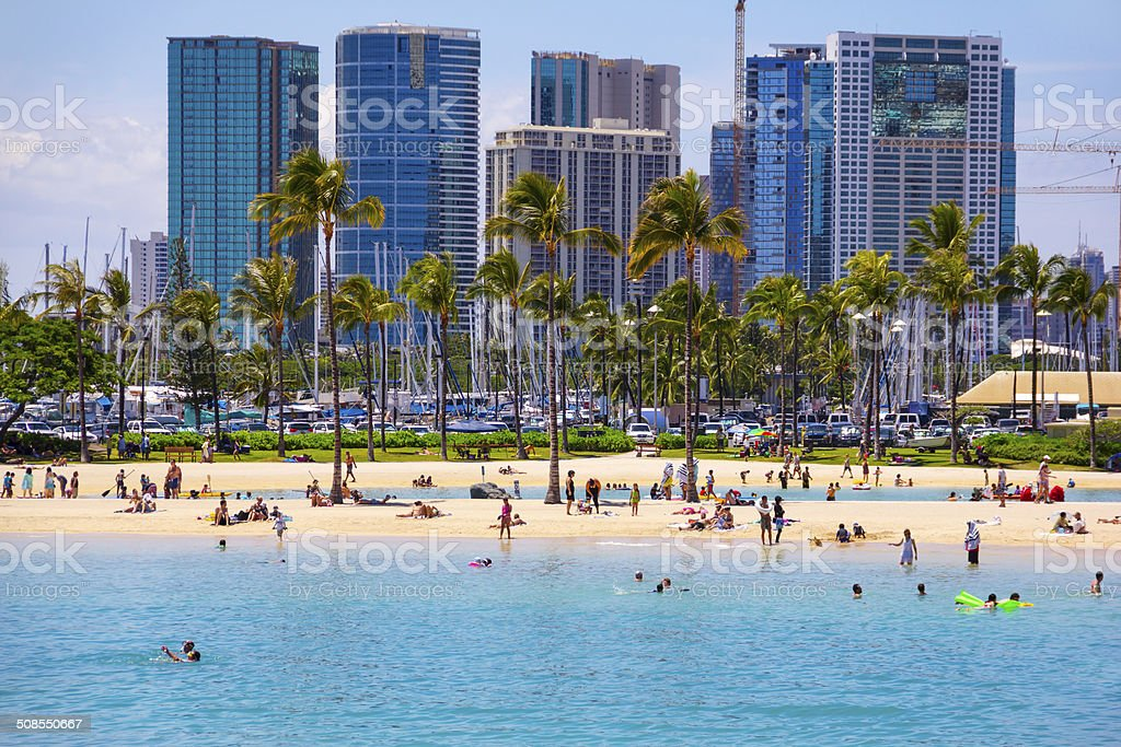Tourists Swimming, Sunbathing on Waikiki Beach, Honolulu, Oahu, Hawaii. stock photo