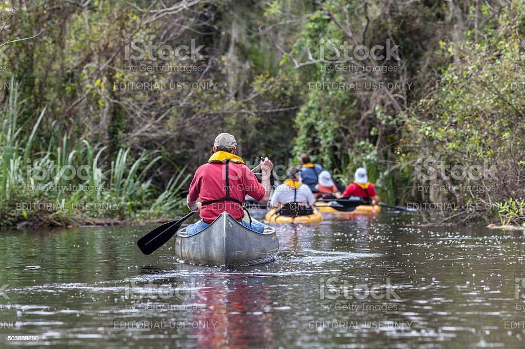 Tourists Take a Guided Tour Down the Turner River stock photo