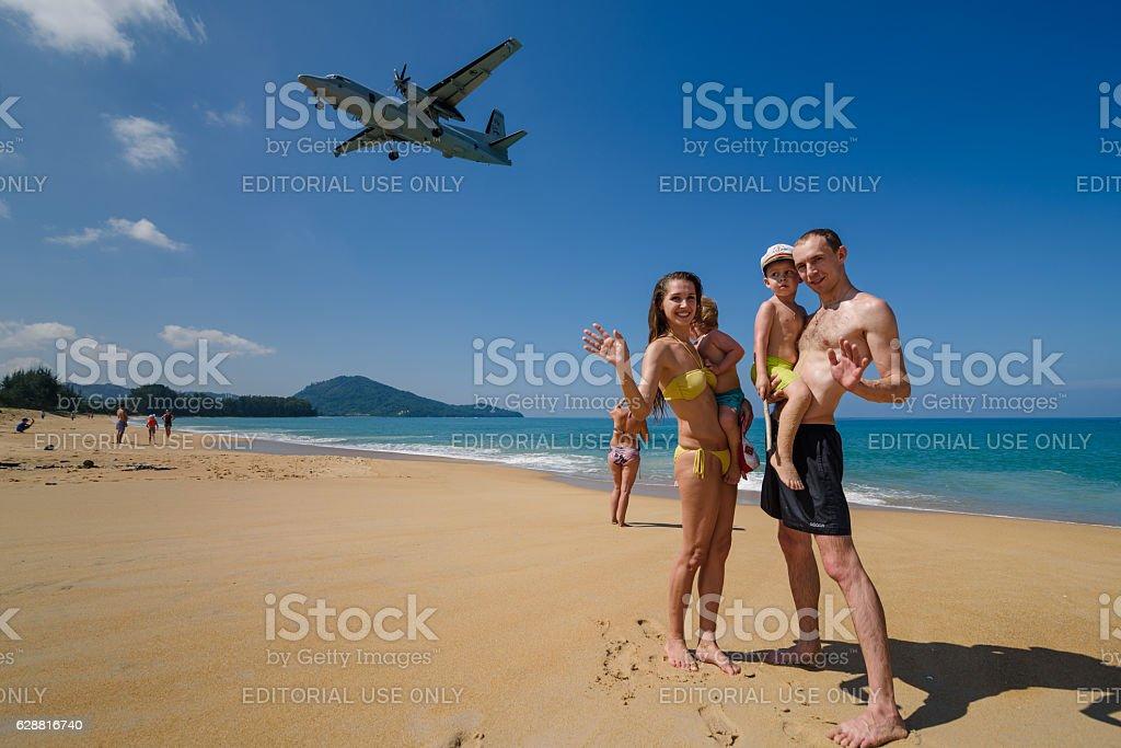 tourists take a photo with plane landing at Phuket airport stock photo
