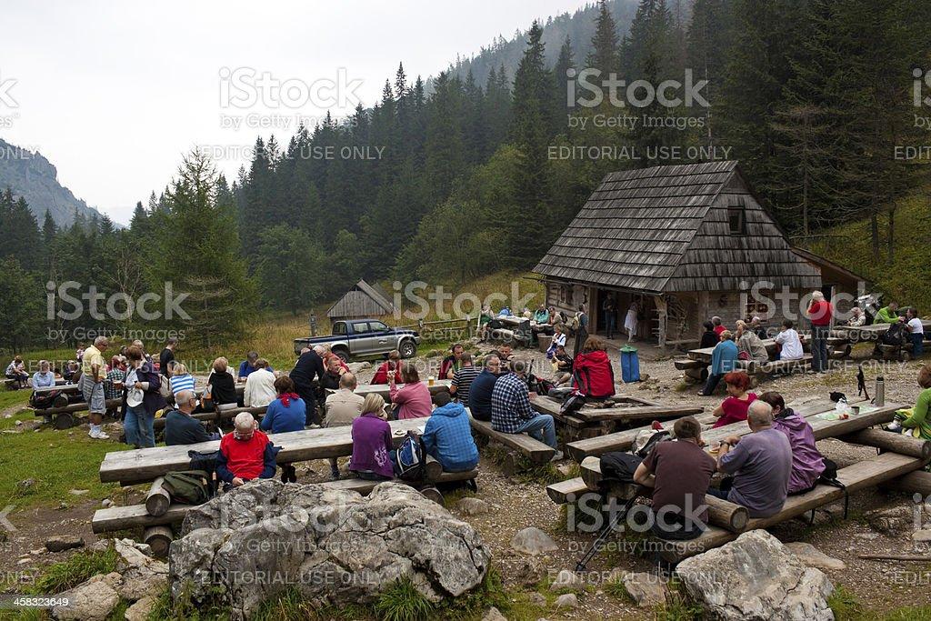 tourists take a rest on Strazyska Meadow in Tatra royalty-free stock photo