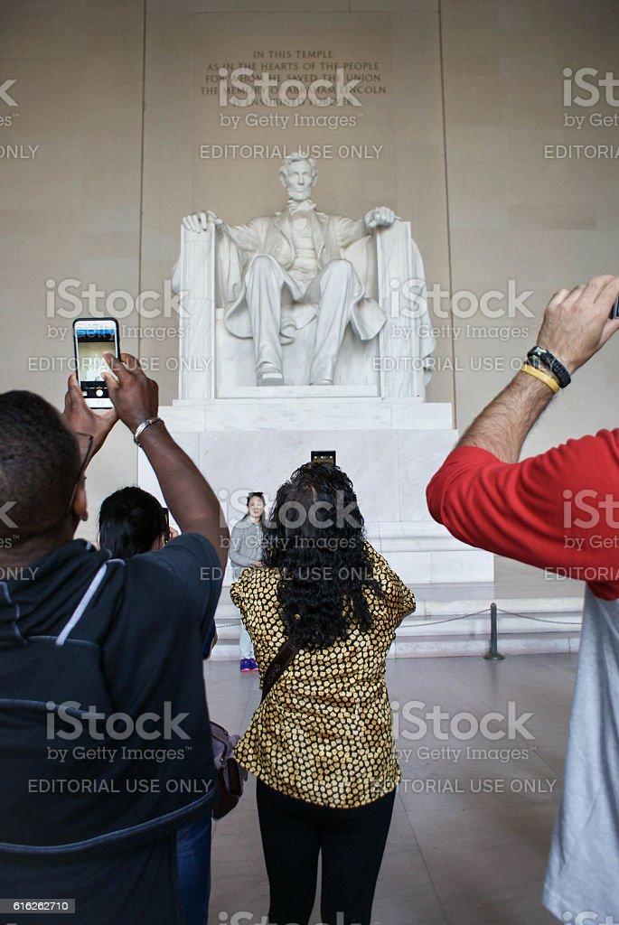 Tourists take photos of the Iconic Lincoln statue, Washington stock photo